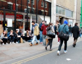 People eating on the floor, that's behavior in Brick Lane